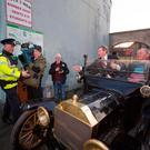 Taoiseach Enda Kenny arrives in a Model T Ford for the launch of the Action Plan for Regional Development in Ballymahon, Co Longford. Photo: Mark Condren