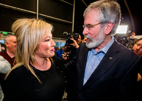 Michelle O'Neill, Sinn Fein's leader in the North, is greeted by Sinn Fien President Gerry Adams as she arrives at the Titanic Exhibition Centre, Belfast for the Assembly election count. Photo: Liam McBurney/PA