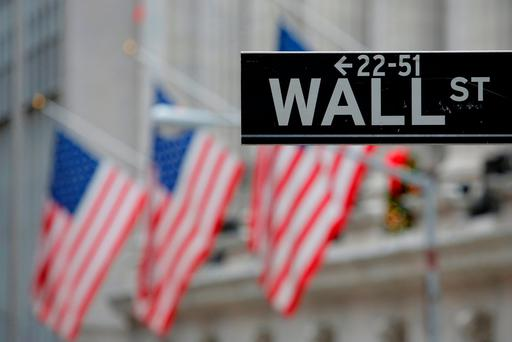 A street sign for Wall Street is seen outside the New York Stock Exchange (NYSE) in Manhattan