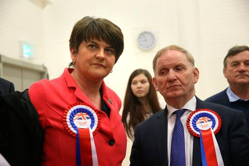 DUP party chairman Lord Morrow (right) with DUP leader Arlene Foster at Omagh count centre as he failed to be re-elected in Northern Ireland's Assembly election. Photo: Brian Lawless/PA Wire
