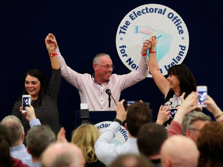 Sinn Fein candidates for Fermanage South Tyrone Jemma Dolan (left), Sean Lynch and Michelle Gildernew at the Omagh count centre having been deemed elected in Northern Ireland's Assembly election. Photo: Brian Lawless/PA Wire