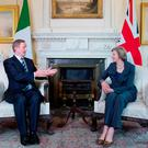Taoiseach Enda Kenny knows Ireland is closer to London and UK Prime Minister Theresa May than to Brussels and the EU. Photo: PA