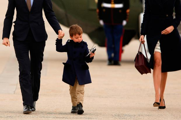 U.S. President Donald Trump's grandson Joseph Kushner holds a toy helicopter as he and his parents Jared Kushner and Ivanka Trump board Air Force One with the president for travel to Florida from Joint Base Andrews, Maryland, U.S. March 3, 2017. REUTERS/Jonathan Ernst