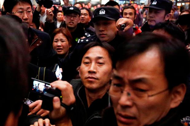 North Korean national Ri Jong Chol (C) is surrounded by media after his arrival at Beijing airport, China, March 4, 2017. REUTERS/Thomas Peter