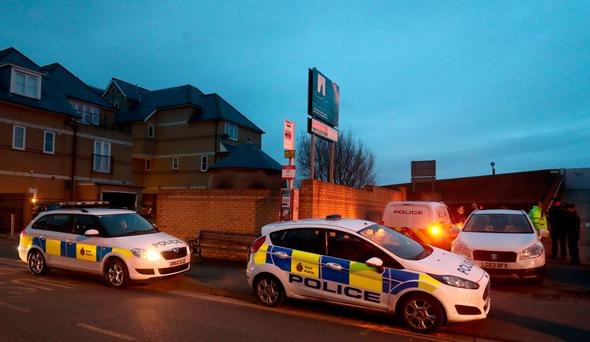 Police offices at the cordon, near to the scene in Sheerness, Kent, where the remains of an infant where discovered. Photo Gareth Fuller/PA Wire