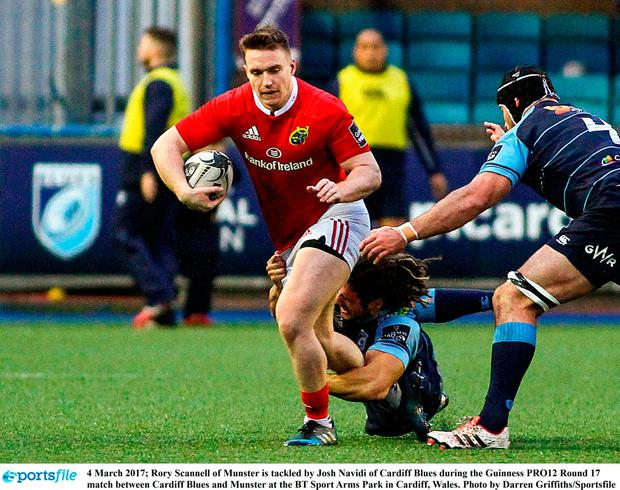 Rory Scannell of Munster is tackled by Josh Navidi of Cardiff Blues