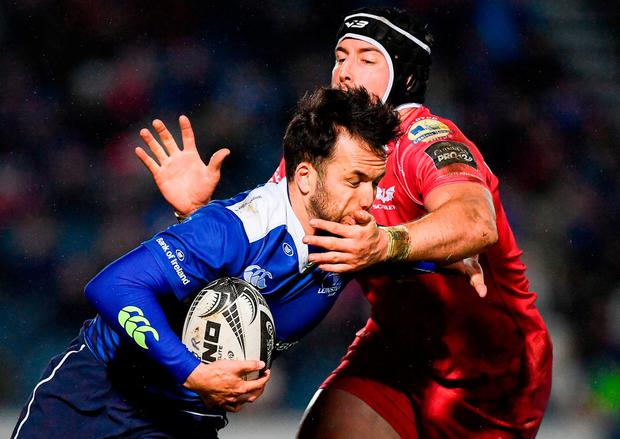 Leinster's Jamison Gibson-Park is tackled by Scarlets' DTH van der Merwe. Photo: Ramsey Cardy/Sportsfile
