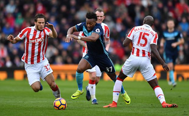 Middlesbrough's Adama Traore finds a way between Stoke City's Bruno Martins Indi and Ramadan Sobhi. Photo: Reuters