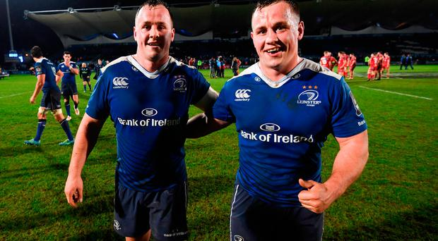 Ed Byrne, left, and his twin brother Bryan following the Guinness PRO12 Round 17 match between Leinster and Scarlets