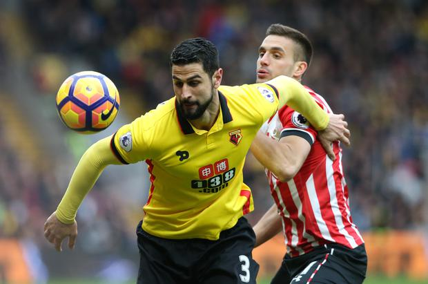 Watford's Miguel Britos fends off Southampton's Dusan Tadic. Photo: Reuters