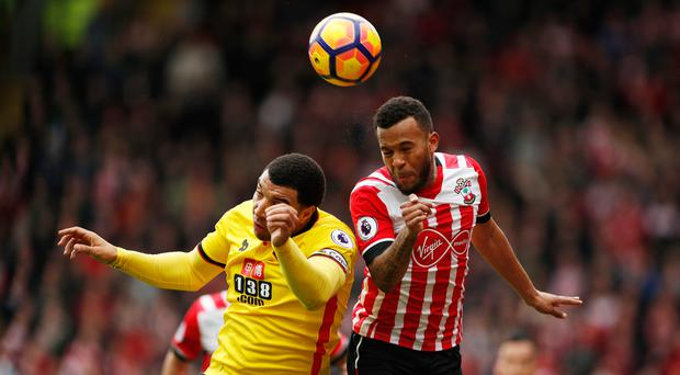 Watford's Troy Deeney rises with Southampton's Ryan Bertrand. Photo: Reuters