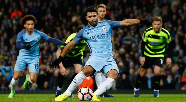 Manchester City's Sergio Agüero scores from the penalty spot against Huddersfield in the FA Cup. Photo: Reuters
