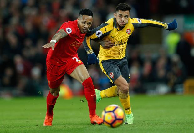 Arsenal's Alexis Sanchez battles for the ball with Liverpool's Nathaniel Clyne. Photo: Reuters