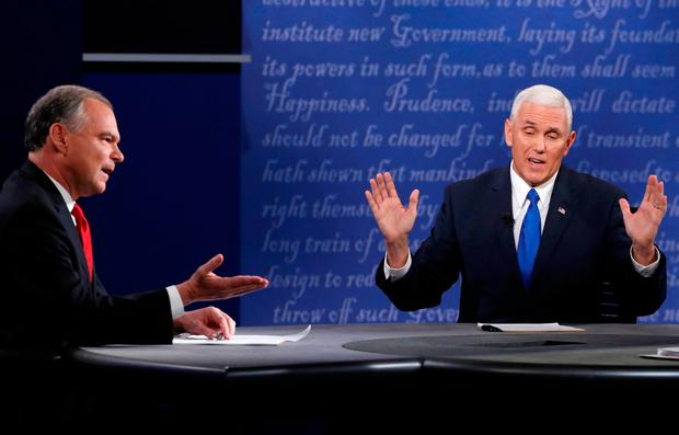 FILE PHOTO - Democratic U.S. vice presidential nominee Senator Tim Kaine (L) and Republican U.S. vice presidential nominee Governor Mike Pence discuss an issue during their vice presidential debate at Longwood University in Farmville, Virginia, U.S. on October 4, 2016. REUTERS/Jonathan Ernst/File Photo