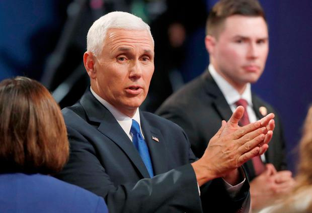 Republican U.S. vice presidential nominee Governor Mike Pence claps as he talks to the audience after the conclusion of the vice presidential debate against Democratic U.S. vice presidential nominee Senator Tim KaineREUTERS/Jonathan Ernst/File Photo