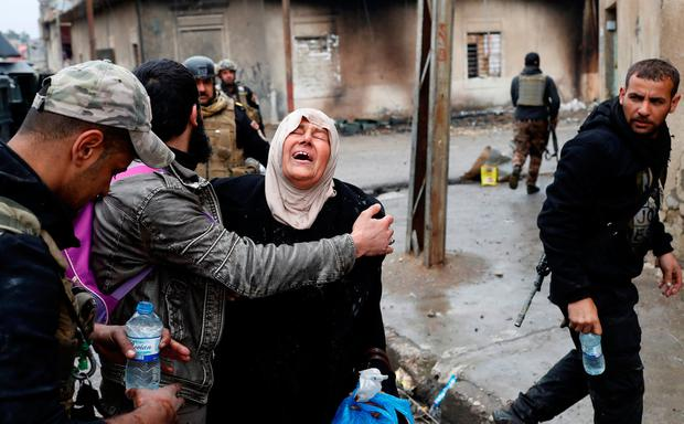A woman cries after crossing from Islamic State controlled part of Mosul to Iraqi forces controlled part of Mosul, Iraq, March 4, 2017. Picture taken March 4, 2017. REUTERS/Goran Tomasevic