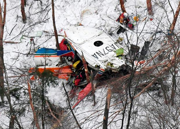 Rescuers work near the helicopter crashed in mountains in Nagano prefecture, central Japan Sunday, March 5, 2017. (Daisuke Suzuki/Kyodo News via AP)