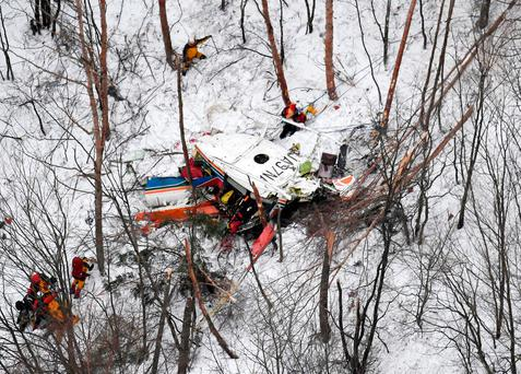 Rescuers work near the helicopter crashed in mountains in Nagano prefecture, central Japan Sunday, March 5, 2017.(Daisuke Suzuki/Kyodo News via AP)