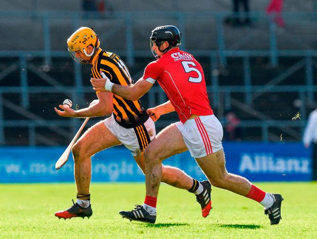 Kilkenny's Colin Fennelly in action against Cork's Christopher Joyce. Photo: Ray McManus/Sportsfile