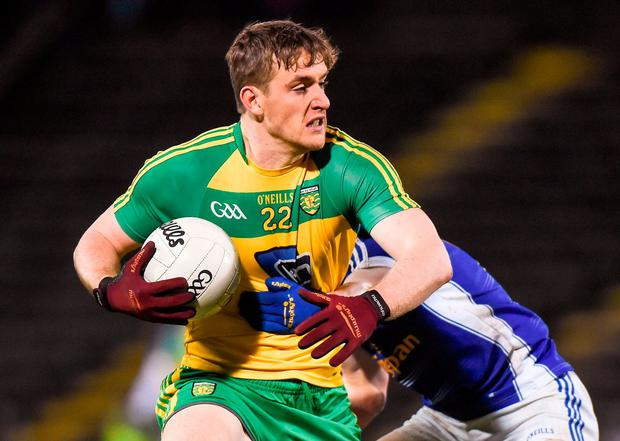 Donegal's Hugh McFadden getting tackled. Photo: Matt Browne/Sportsfile