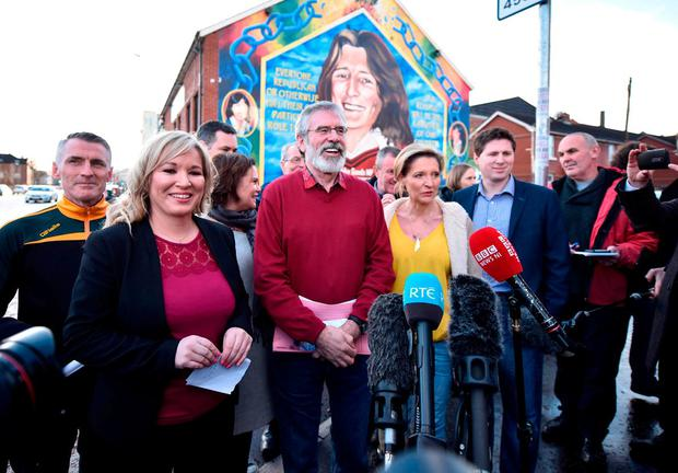 Sinn Féin President Gerry Adams and North leader Michelle O'Neill, left, hold a press conference at the party's headquarters in Belfast after it increased its vote significantly in the Assembly election.Photo: Getty