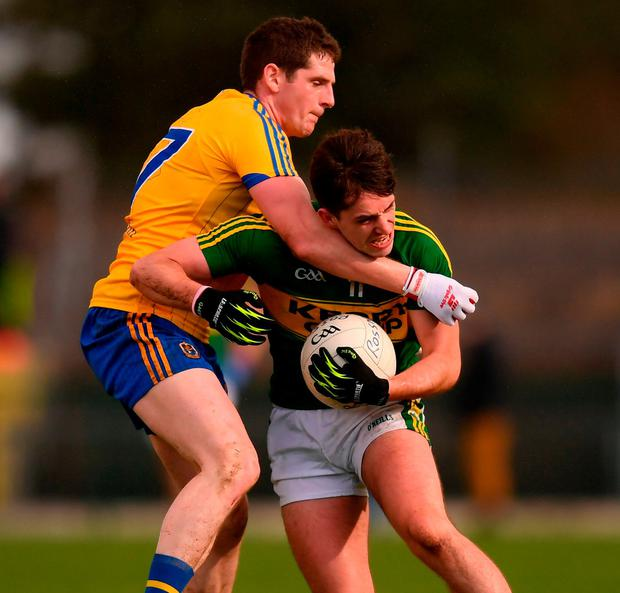 Kerry's Jack Savage in action against Roscommon's Conor Devaney. Photo: Stephen McCarthy/Sportsfile