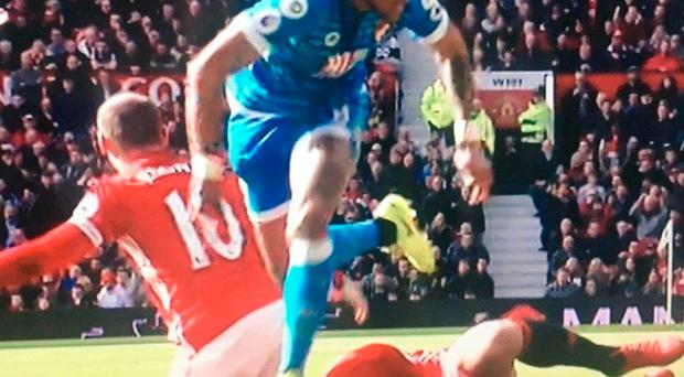 Mings appeared to stand on the head of the striker
