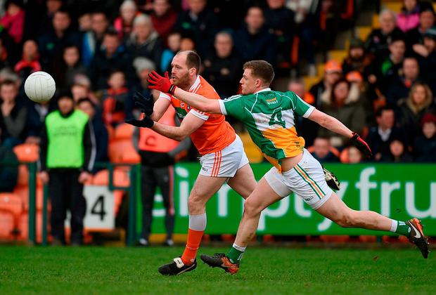Armagh's Ciaran McKeever in action against Offaly's Sean Pender. Photo: Philip Fitzpatrick/Sportsfile