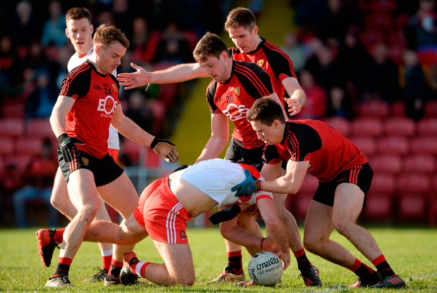 Derry's Emmett McGuckin is surrounded by Down players Brendan McArdle, Ryan McAleenan, Aidan Carr and Niall Donnelly Photo: Oliver McVeigh/Sportsfile