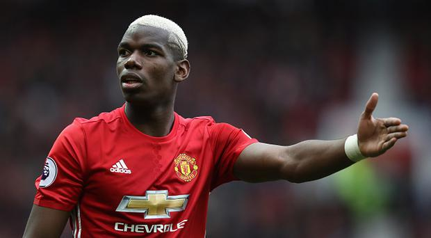 MANCHESTER, ENGLAND - MARCH 04: Paul Pogba of Manchester United reacts during the Premier League match between Manchester United and AFC Bournemouth at Old Trafford on March 4, 2017 in Manchester, England. (Photo by Julian Finney/Getty Images)
