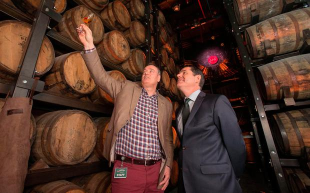 Ray Dempsey, left, general manager of Jameson Distillery Bow Street, with Public Expenditure and Reform Minister Paschal Donohoe at the reopening yesterday. Photo: Gareth Chaney