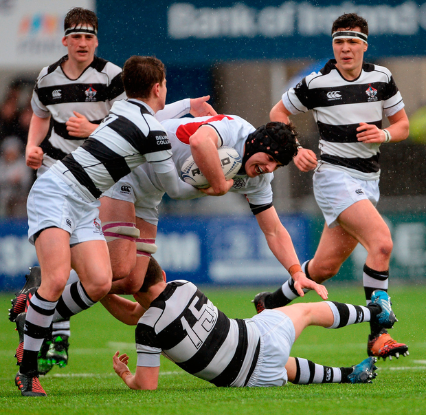 Sean McCrohan of Clongowes Wood College is tackled by Paraic Cagney (left) and Hugh O'Sullivan of Belvedere College Photo: Piaras Ó Mídheach/Sportsfile