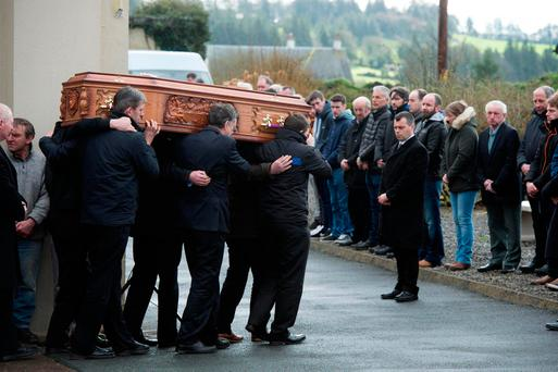 The remains of Paddy Lyons are carried from Ballysaggart Church. Photo: Michael Mac Sweeney/Provision