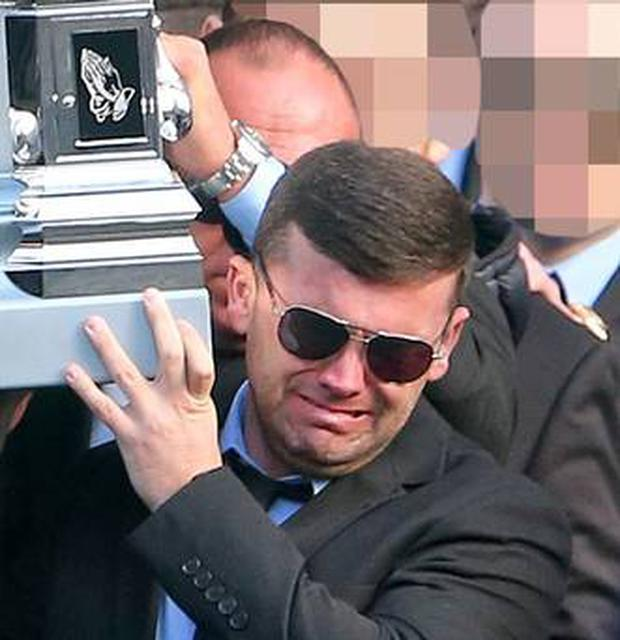 Liam Byrne pictured at the funeral of his brother David