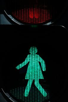 Female traffic light signals are installed at the intersection of Swanston and Flinders streets in Melbourne, Australia Photo: Getty