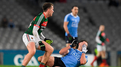Philip McMahon of Dublin holds his face after a clash with Cillian O'Connor of Mayo