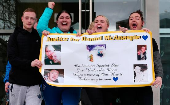 Family and friends of the late Daniel McAnaspie celebrate outside the Central Criminal Court in Dublin after Richard Dekker was found guilty of his murder in 2010. Photo: Collins Courts