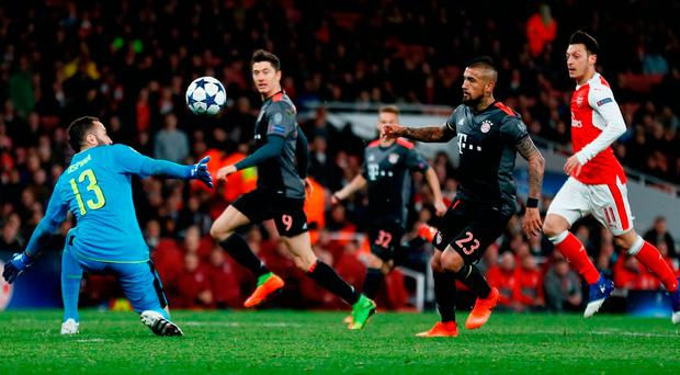 Arturo Vidal dinks the ball over David Ospina to score for Bayern Munich. Photo: Stefan Wermuth/Reuters