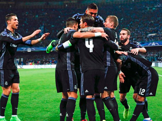 Real Madrid's Sergio Ramos celebrates with teammates after scoring against Napoli