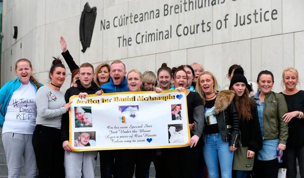 Daniel McAnaspie's family and friends cheer the verdict outside court.