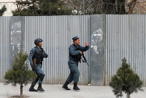 Afghan policeman arrive at the site of a blast and gunfire in Kabul, Afghanistan March 8, 2017. REUTERS/Mohammad Ismail