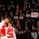 Arsenal fans hold up banners protesting against Arsenal manager Arsene Wenger. Action Images via Reuters / John Sibley