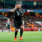 Bayern's Arturo Vidal celebrates after scoring his side's fourth goal last night