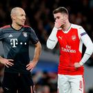 Bayern Munich's Arjen Robben speaks with Arsenal's Aaron Ramsey last night