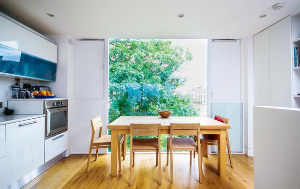 Alec Darragh's aluminum clad North Dublin terrace: The view from the kitchen is dual aspect, and overlooks both the front and back of the property from a height