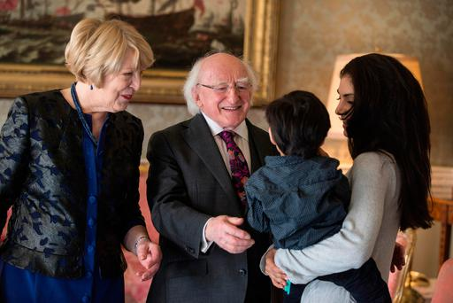 Michael D Higgins and wife Sabina welcome Aradhana Ghai and son Ishaan (2) to a reception to mark International Women's Day. Photo: Mark Condren