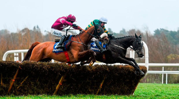 Tombstone (left), here losing out to Bleu Et Rouge last season, will skip the Champion Hurdle to run in the Coral Cup Picture: Ramsey Cardy / SPORTSFILE