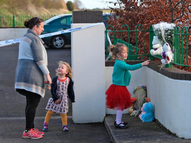 Neighbours bring flowers and teddy bears. Photo: Collins