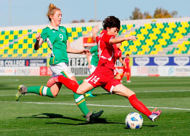North Korea's Ri Hyangsim (right) fights for the ball against Ireland's Megan Connolly. Photo: Florian Choblet/AFP/Getty Images