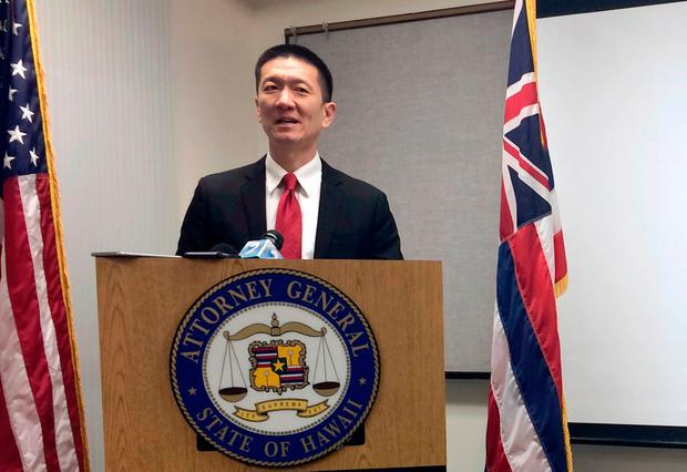 Hawaii Attorney General Doug Chin speaks at a news conference in Honolulu announcing the state of Hawaii has filed a lawsuit challenging President Donald Trump's travel ban (AP Photo/Audrey McAvoy, File)